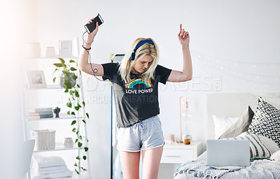 Buy stock photo Cropped shot of an attractive young woman listening to music and dancing in her bedroom at home