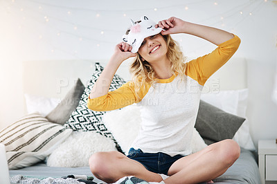 Buy stock photo Full length portrait of an attractive young woman wearing a sleeping mask while relaxing in her bedroom at home