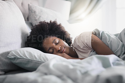 Buy stock photo Shot of an attractive young woman sleeping in her bed in the morning at home