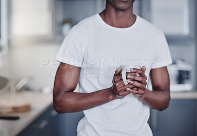 Buy stock photo Cropped shot of a man having coffee during the morning at home