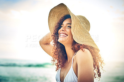 Buy stock photo Cropped shot of an attractive young woman looking thoughtful while standing on the beach