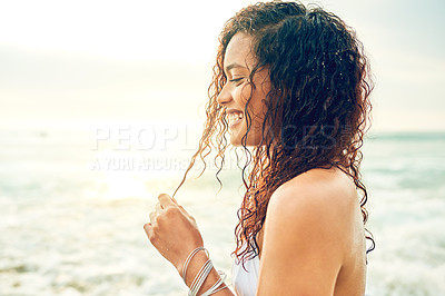 Buy stock photo Cropped shot of an attractive young woman standing on the beach