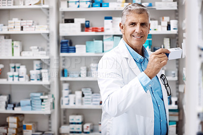 Buy stock photo Shot of a pharmacist working in a drugstore