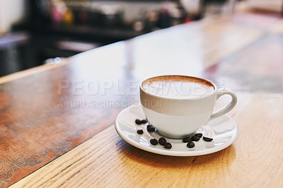 Buy stock photo Shot of a cup of coffee on a table in a coffee shop