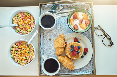 Buy stock photo High angle shot of a breakfast laid out on a tray on a bed