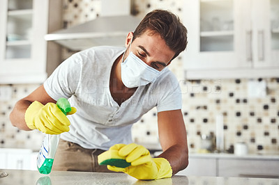 Buy stock photo Cropped shot of a handsome young man cleaning his home