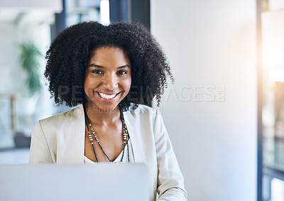 Buy stock photo Portrait of a young businesswoman smiling and in good spirits at her office desk