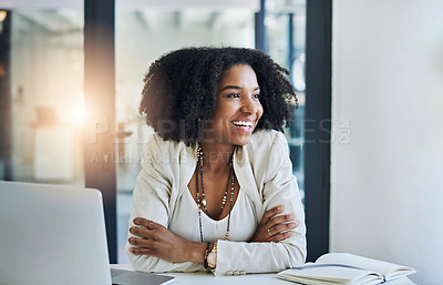 Buy stock photo Shot of a young businesswoman smiling and looking out of a window in her office