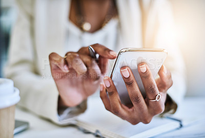 Buy stock photo Shot of an unrecognizable businesswoman using her cellphone at her office desk