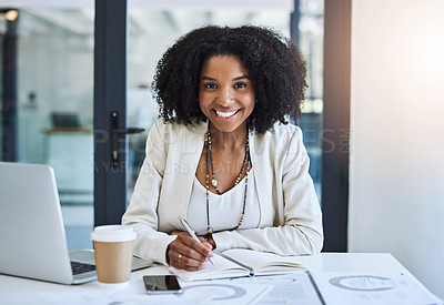 Buy stock photo Portrait of a young businesswoman smiling and ing good spirits at her office desk