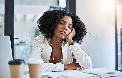 Buy stock photo Shot of a young businesswoman taking a nap at her office desk