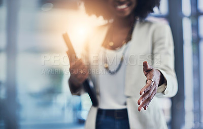 Buy stock photo Shot of an unrecognizable businesswoman reaching out for a handshake