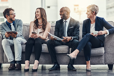 Buy stock photo Full length shot of a group of businesspeople brainstorming together in an office