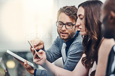 Buy stock photo Cropped shot of a group of businesspeople brainstorming together in an office