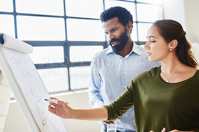 Buy stock photo Cropped shot of two businesspeople brainstorming together in an office