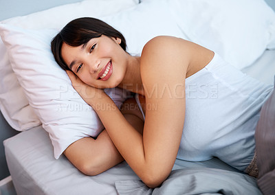 Buy stock photo Shot of a cheerful attractive young woman sleeping in her bed at home in the morning
