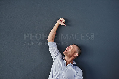 Buy stock photo Studio shot of a mature man raising his hand against a grey background