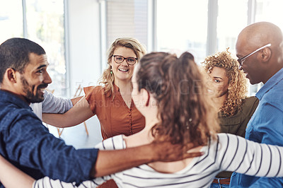 Buy stock photo Shot of a group of people standing in a circle together
