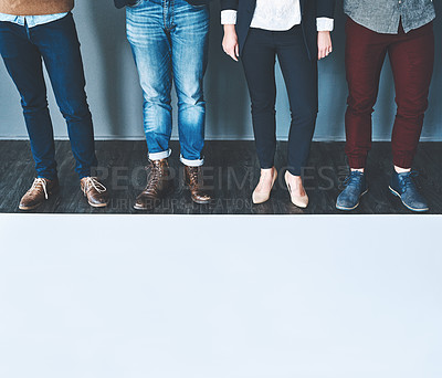 Buy stock photo Studio shot of a group of unrecognisable people standing in a row against a grey background