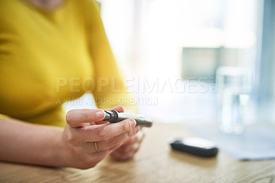 Buy stock photo Cropped shot of an unrecognizable young businesswoman at work