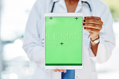 Buy stock photo Cropped shot of a doctor holding a digital tablet with a green screen