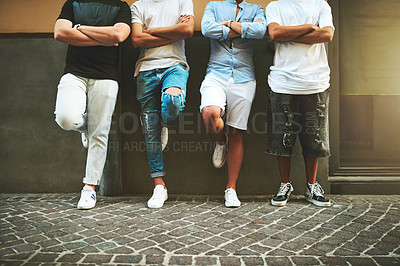 Buy stock photo Cropped shot of a group of friends hanging out in the city