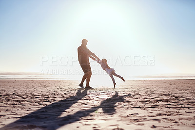 Buy stock photo Shot of an adorable little girl having fun with her father at the beach