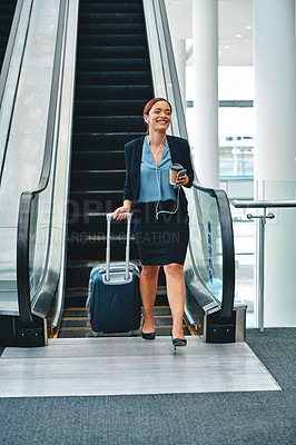 Buy stock photo Cropped shot of an attractive young businesswoman making a phonecall while walking through the airport