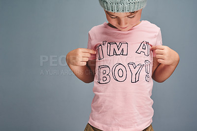 Buy stock photo Studio shot of an adorable little boy posing against a grey background