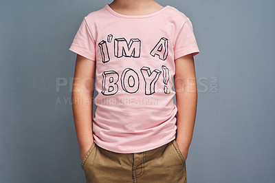 "Buy stock photo Studio shot of a boy wearing a t shirt with ""I'm a boy"" printed on it against a grey background"