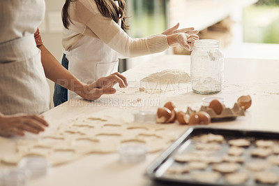 Buy stock photo Cropped shot of an unrecognizable person baking at home