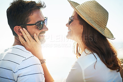 Buy stock photo Cropped shot of an affectionate young couple enjoying a summer's day outdoors