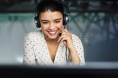 Buy stock photo Cropped shot of an attractive young businesswoman working late in a call center