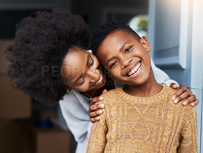 Buy stock photo Portrait of a little boy standing with his mother at the front door of their house