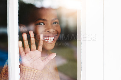 Buy stock photo Shot of a happy little boy looking out the window at home