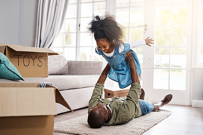 Buy stock photo Shot of a father and his little daughter having fun while moving house