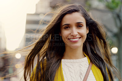 Buy stock photo Portrait of a young woman smiling and in good spirits in the city