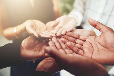 Buy stock photo Closeup shot of a group of businesspeople standing with their hands cupped together