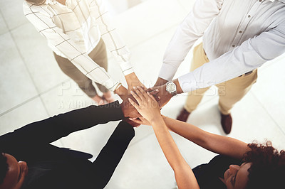 Buy stock photo Closeup shot of a group of businesspeople joining their hands together in a huddle