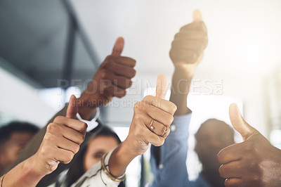 Buy stock photo Closeup shot of a group of businesspeople showing thumbs up in an office
