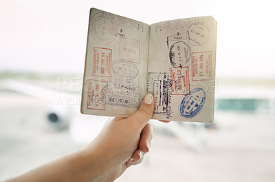 Buy stock photo POV shot of an unrecognizable woman holding a passport indoors