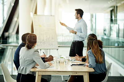 Buy stock photo Cropped shot of a handsome mature businessman giving a presentation in the boardroom