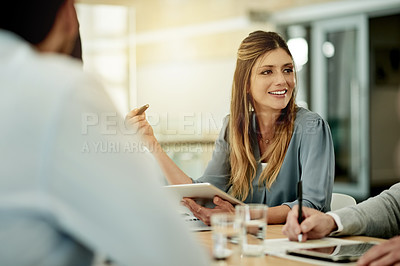 Buy stock photo Cropped shot of an attractive young businesswoman siting in the boardroom during a meeting