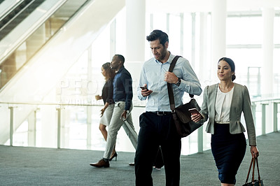 Buy stock photo Cropped shot of businesspeople walking in an office