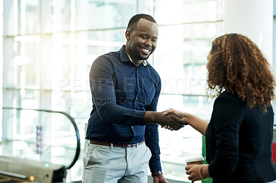 Buy stock photo Cropped shot of a businessman and businesswoman shaking hands in the workplace