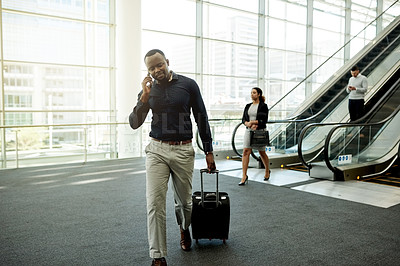 Buy stock photo Shot of a young businessman on a call in the workplace