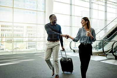 Buy stock photo Shot of businessman and businesswoman shaking hands in the workplace