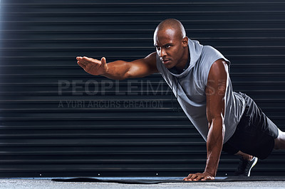 Buy stock photo Shot of a handsome young man doing push-ups