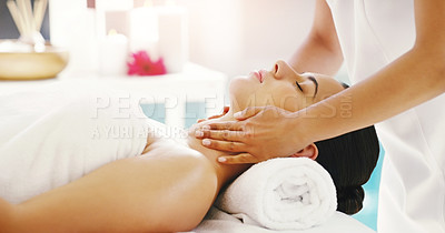 Buy stock photo Shot of a young woman getting a massage at a spa