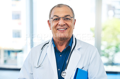 Buy stock photo Cropped portrait of a mature doctor working in the hospital